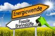 Wegweiser mit Energiewende und Fossile Brennstoffe