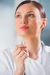 Female medical doctor - dentist - showing chewing gum. Dental ca