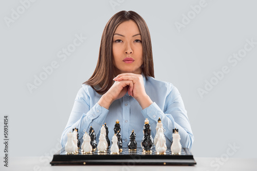 Concept of Strategy in business - business woman sitting in fron