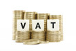 VAT (Value Added Tax) on gold coins on white background