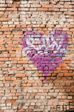 Heart graffiti on old brick wall