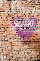 Heart graffiti on old brick wall