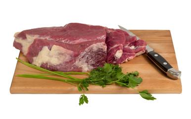 Raw meat on a cutting board