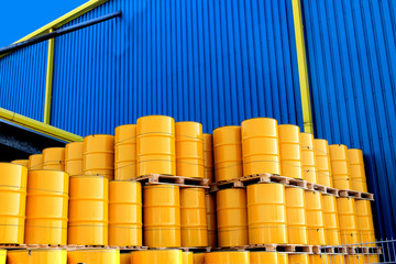Yellow oil drums and factory