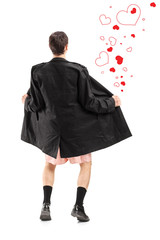 Full length portrait of a flasher in a coat, and hearts around h