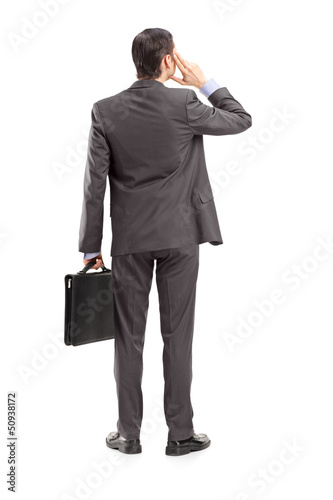 Full length portrait of a businessman thinking, shot from behind