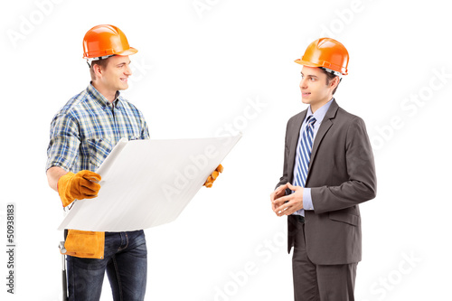 Male engineer holding a blueprint and having a conversation with