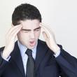 Geschaeftsmann mit Kopfschmerzen