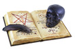 Magic book isolated with black skull and feather