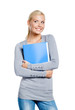 Female in grey sweater hands folder with documents