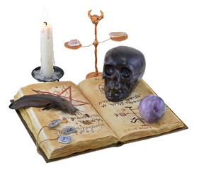 Magic book isolated with black skull and candle