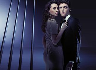 Sensual woman holding her boyfriend very close