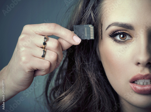 Sensual woman inserting card into her head
