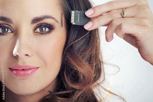 Young smiling woman inserting card into her head