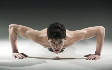 Muscular young man  pressing-ups