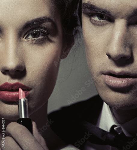 Portrait of a woman and man with lipstick