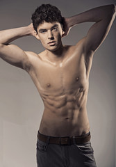 Young handsome athlete in nice pose