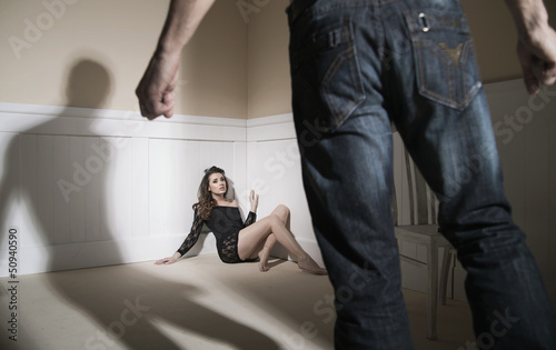 Scene of man and woman expressing domestic violence