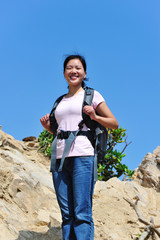 young hiking woman stand mountain peak