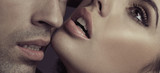 Young couple and sensual lips of lady