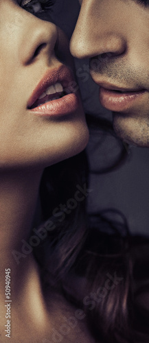 Picture of close-up faces of two lovers © konradbak
