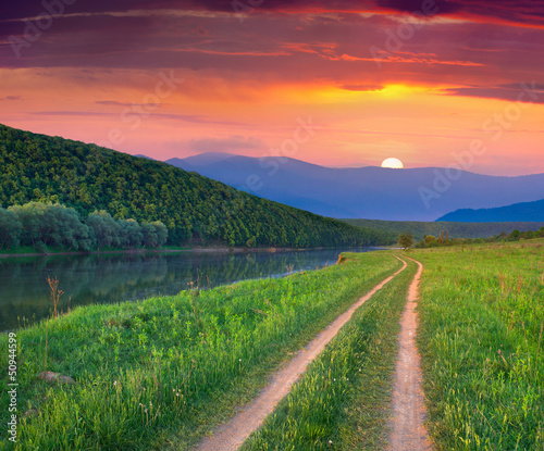 Beautiful summer landscape on the mountain river. Sunrise
