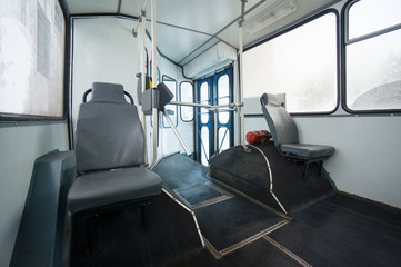 Front side of old trolley bus with seats and doors after renovat