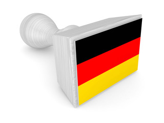 Wooden stamp with german flag.