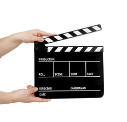 human hand holding a movie clapboard