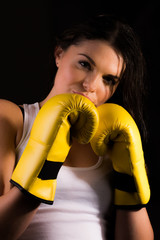Young sporty female with boxing gloves