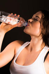Sports women drinking bottle of water