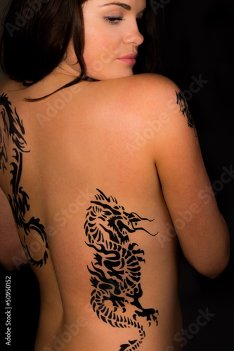 Beautiful female with tribal tattoos on her back