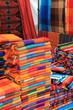 Colorful fabric for sale at a Mexican craft market