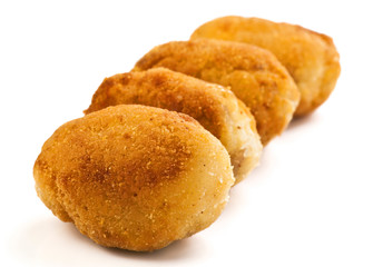 group filled with gold croquettes on white base