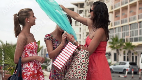 Girlfriends checking their shoppings in the city