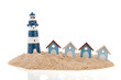 Beach huts and lighthouse in the sand