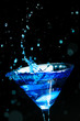 blue splashing cocktail on black