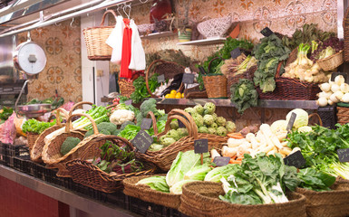 Market stand with green vegetables