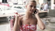 Woman talking on cellphone in the city, super slow motion