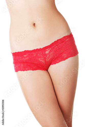 Fit woman body in red panties