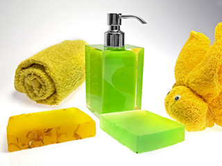colored soap dispenser and towels