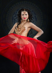 Portrait of belly dancer in red costume