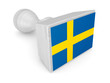 Wooden stamp with swedish flag.
