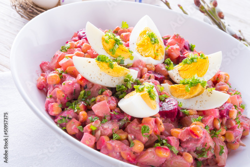 Red beet salad with egg