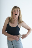 Woman shocked expression body fat caliper guage