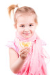 Sick little girl with chickenpox eating lemon