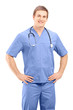 A male medical practitioner in a uniform posing