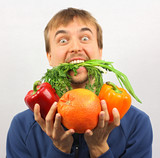 man gone mad on fresh vegetables and fruits