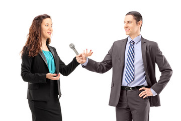 A businesswoman and male reporter having an interview