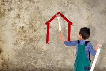 Junge malt ein Haus